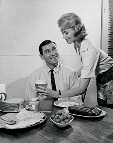 Woman serving man food