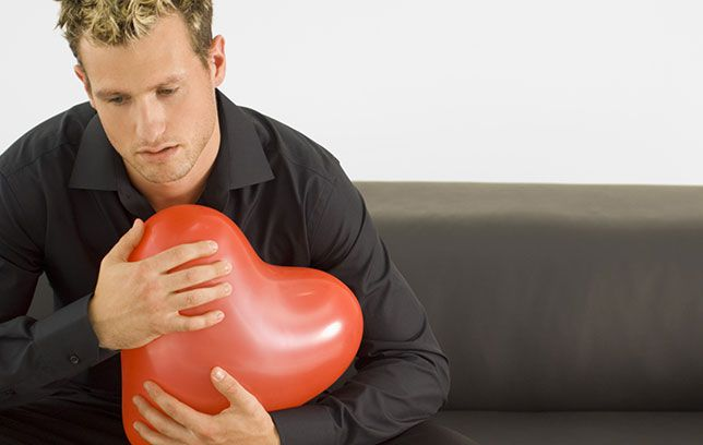 man protecting heart