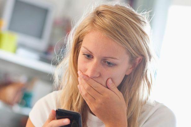 texting girls - girl worried