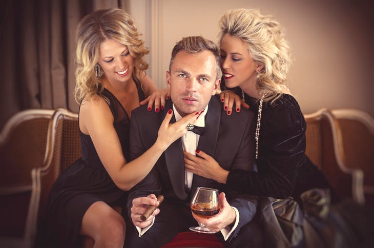 sexual social proof - man with two women