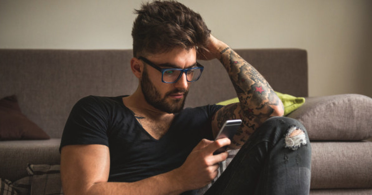 man spending too much time on dating apps